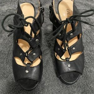 Two pairs of guess shoes